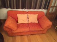 Sofa bed with sprung mattress bed, orange material, hardly used, good condition, although faded.