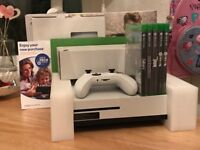 Xbox one s boxed with 5sealed game and two pads