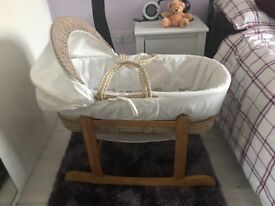 Moses basket with rocking stand in oak finish.