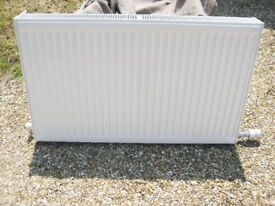 Double Panel Radiator With Valves And Brackets And Fitted Grilles.