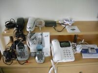 A variety of telephones & a call blocker with their wires and plugs - all in a working condition.