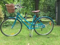 Brand new turquoise Electra bicycle with detachable basket and hybrid tyres