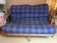 Metal framed two seater sofa futon bed