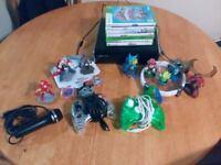 Microsoft Xbox 360 SLIM Black + 2 Controllers + 7 Games + A lof of Figures + Microphone