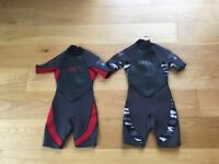 Two children's Xcel wetsuits size age 8 and 10 in excellent condition