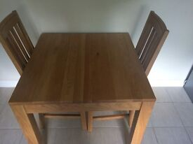 Good quality oak table and 2 chairs