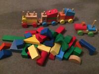 Wooden train and building bricks