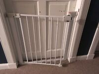 Two stair gates sold together.