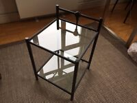 Glass table with cast iron frame