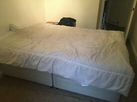 Small double bed with two drawers