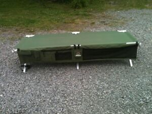 Two Cabela's army cots & nightstands - price negotiable