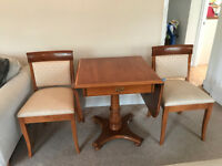 Drop leaf table with 2 chairs. excellent condition