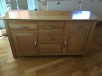 Modern warm light oak sideboard with 2 doors/5 drawers with brushed chrome handles
