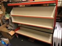 Metal double sided shelving unit on wheels