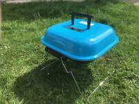 "Portable Barbecue with three ""light & go"" charcoal bags. BBQ used once and in immaculate condition!"