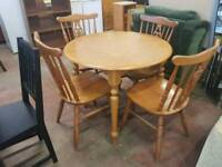 Round pine table with four chairs