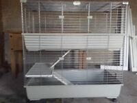 Large two level guinea pig cage excellent condition with wheels £45 ono.