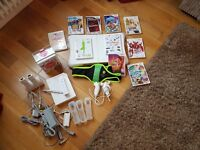 Nintendo Wii Console + Wii Fit board, Nun-chucks & Games Package