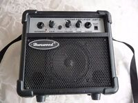 Portable amplifier for guitar or other instrument. Mains or battery operation.