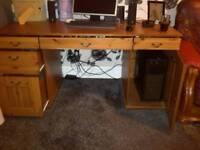 Dark coloured pine computer desk