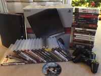 PS3 console, controllers x 2, cables, games. Extra console and 22 games free.