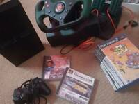 Huge Playstation bundle! Console, steering wheel, games. Great condition.