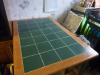 green tiled table and chairs