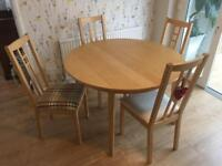 Ikea beech extending round table with 4 Aron chairs.