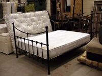 Black double metal bed frame and Deluxe Beds mattress