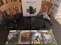 XBox 360 250GB, 4 games inc GTA V, 2 wireless controllers & charging stand