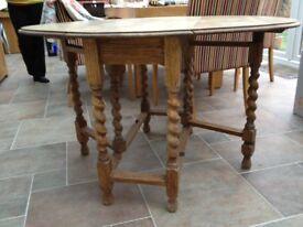 Antique oval OAK ornate barley twisted gate leg drop leaf dining table.