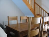 Light oak dining table and 4 chairs