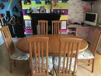 Large extendable table and 6 chairs