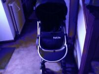 Baby go pushchair black with rain covers and shopping basket