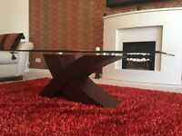 Beautiful designer coffee table in glass and dark wood