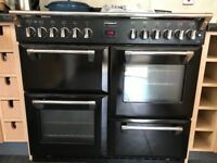 Stoves Range cooker for sale. Black with 4 electric ovens and 7 gas burners.