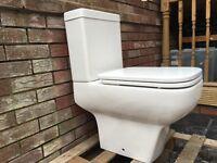 Toilet WC white some damage Bathroom rented property garage workshop