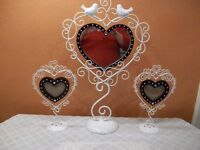 heart shaped mirror and picture frames