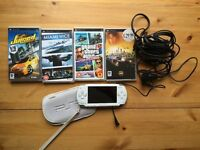 SONY PSP with CHARGER and 4 exciting GAMES