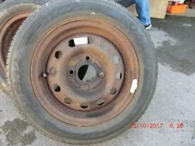 Two new roadstone tyres on wheels for 15 pounds (as shown)
