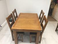 Solid oak extending dining table with 6 chairs