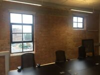 self contained warehouse style office 8-10 desk with separate meeting room