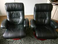 Pair of leather chairs and footstools