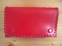 NEW and un-used red leather-effect purse, 3 sections. Excellent condition. £3 ovno.