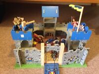 Toy wooden castle with soldiers and horses. Great condition. Hardly used. Great present.