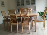 Danish design birch dining table and 6 chairs, made in Denmark. Six to 10 seater