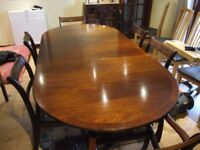 Extending dining table and 6 chairs.