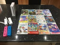 Nintendo wii with 2 control pads and 12 games