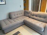 Large grey fabric corner sofa with sofa bed