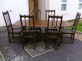 Ercol dining table and 6 chairs set